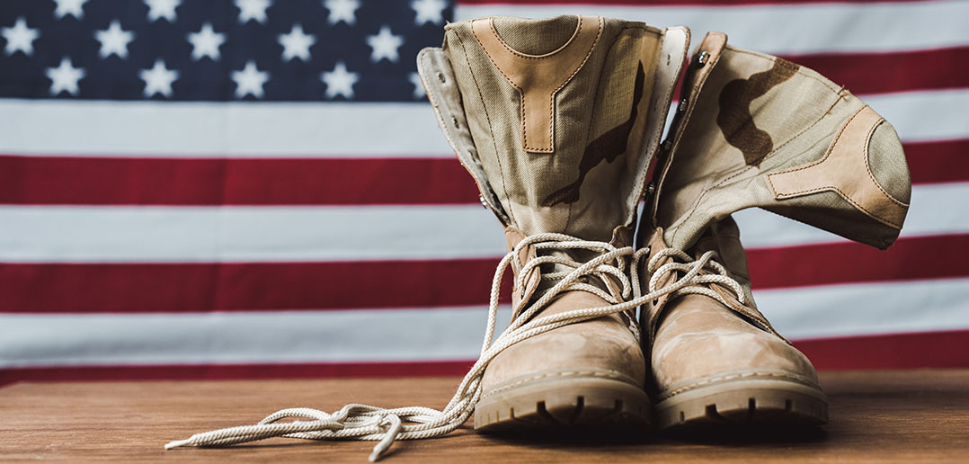 Military boots with American flag in background