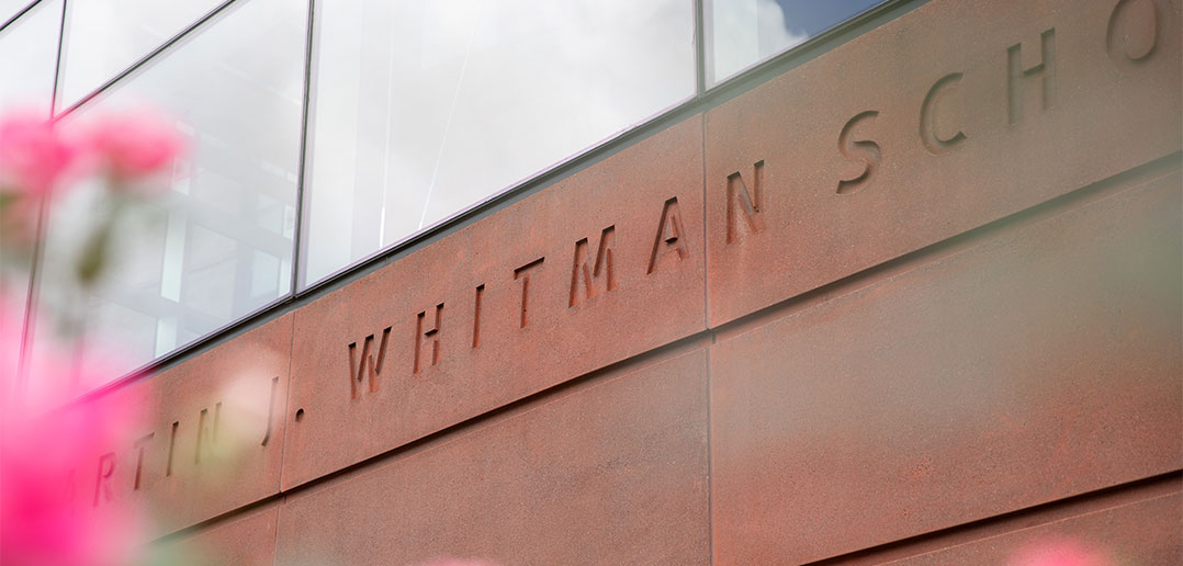 close up of the Martin J. Whitman School of Management engraving on the school building