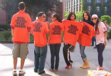 Eclub students in orange shirts