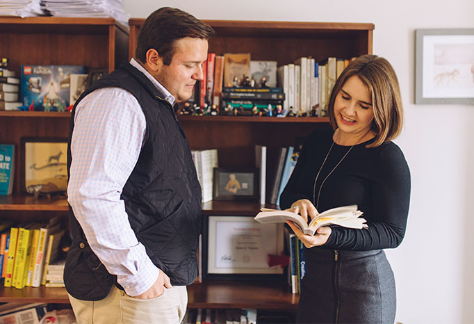 professor and student looking in book