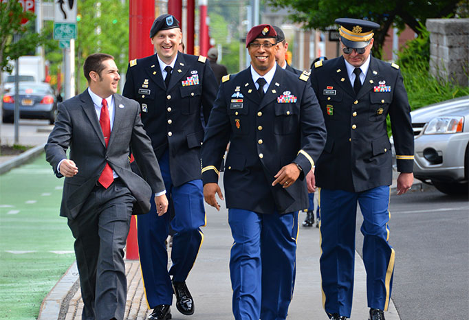 A group of students in their military uniforms walking outside Whitman