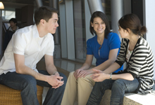 A group of students having a conversation.